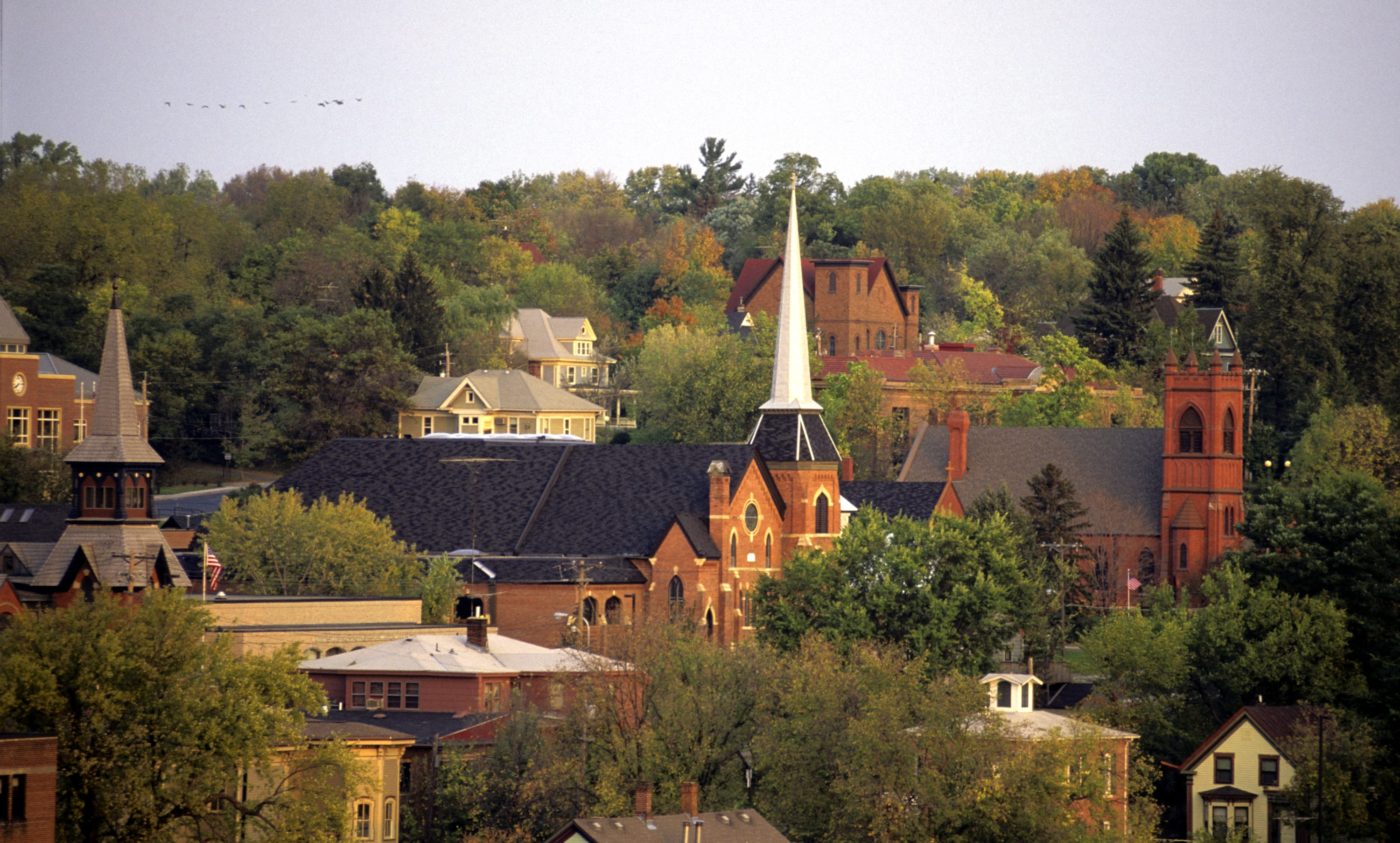 Church steeples and other buildings in the Stillwater skyline.