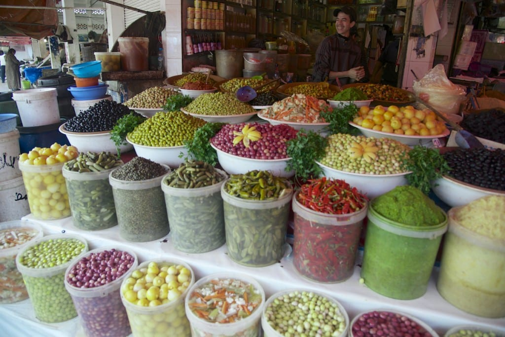 Markets and Vendors - Man and Colorful Market Stall Display - Casablanca, Morocco - Copyright 2014 Ralph Velasco