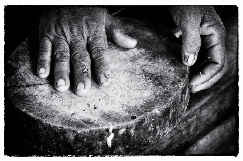 Storytelling Closeups and Details - Lady's Hands Making Medicine - Silk Island, Cambodia - Copyright 2013 Ralph Velasco