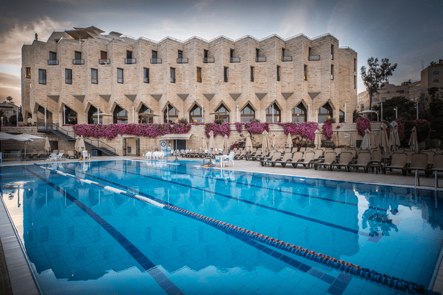 Outdoor pool at The Inbal Hotel